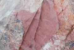 Fondo de piedra rojo y blanco de la textura Imágenes de archivo libres de regalías