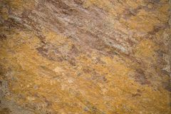 Fondo de piedra texturizado áspero anaranjado fotos de archivo