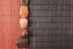 Fondo de piedra y de bambú Imagen de archivo libre de regalías
