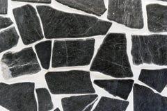 Fondo de piedras negras naturales en el interior imágenes de archivo libres de regalías
