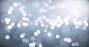 Fondo de plata de la Navidad con el bokeh que fluye, Feliz Año Nuevo del día de fiesta festivo metrajes