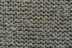Fondo de tejer negro del primer de la tela Imagen de archivo