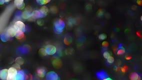 Fondo defocused abstracto de Bokeh de las luces de la Navidad almacen de video