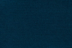 Fondo dei blu navy da una materia tessile con il modello di vimini, primo piano immagini stock