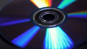 Fondo dei dischi compatti o dei dvds Abbagliamento di luce sul DVD del disco, bello abbagliamento colorato dalla luce, Fotografia Stock