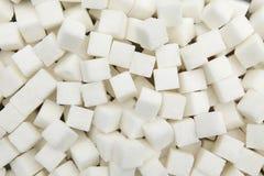 Fondo dei pezzi di zucchero raffinato di bianco dalla barbabietola Fotografia Stock Libera da Diritti