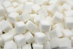 Fondo dei pezzi di zucchero urgente bianco Fotografia Stock Libera da Diritti