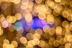fondo dei punti luminosi dell'oro di Bokeh di ฺChristmas Bello indicatore luminoso fotografie stock