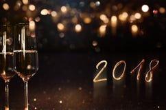 Fondo 2018 del Año Nuevo con champán Fotos de archivo
