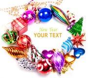 Fondo del Año Nuevo con las decoraciones coloridas Fotografía de archivo libre de regalías