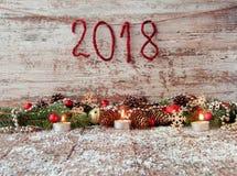 Fondo 2018 del Año Nuevo con los juguetes de la Navidad y la Navidad fresca Imagen de archivo libre de regalías