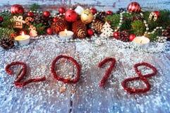 Fondo 2018 del Año Nuevo con los juguetes de la Navidad y la Navidad fresca Fotografía de archivo libre de regalías
