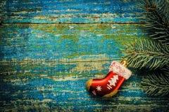 Fondo del Año Nuevo de la Navidad Calcetín rojo Santa Claus del juguete en el w Imagen de archivo libre de regalías