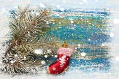 Fondo del Año Nuevo de la Navidad Calcetín rojo Santa Claus del juguete en woode Fotos de archivo libres de regalías