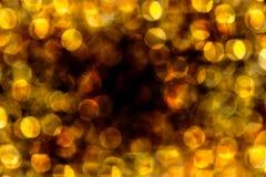 Fondo del amarillo de Bokeh de la luz de la noche Imágenes de archivo libres de regalías