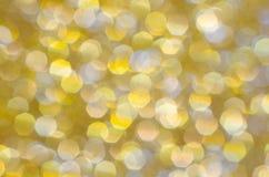 Fondo del amarillo de la chispa y del oro del brillo Fotos de archivo
