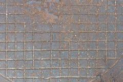 Fondo del arrabio oxidado con el dibujo a cuadros del alivio Fotografía de archivo libre de regalías