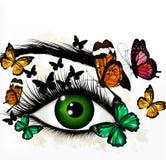 Fondo del arte con el ojo y las mariposas realistas verdes Foto de archivo libre de regalías