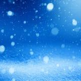 Fondo del azul de la nieve del arte que cae Fotografía de archivo libre de regalías