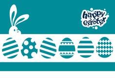 Fondo del azul de la tarjeta de felicitación de la bandera del día de fiesta de Bunny Painted Eggs Happy Easter del conejo Fotos de archivo