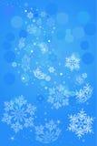 Fondo del azul del copo de nieve Foto de archivo libre de regalías