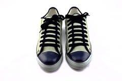 Fondo del blanco de las zapatillas de deporte Foto de archivo libre de regalías