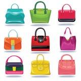 Fondo del blanco del handbagon de las mujeres multicoloras de la moda Fotografía de archivo