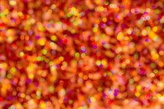 Fondo del bokeh colorido de la textura de la falta de definici?n por festival y A?o Nuevo Juego del color Naranja abstracta de la imagen de archivo