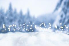 Fondo del bokeh de la Navidad Nevado Fotos de archivo
