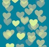 Fondo del bokeh del corazón, objetos borrosos de la foto, amarillos en azul Foto de archivo libre de regalías