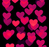 Fondo del bokeh del cuore, oggetti confusi della foto, rossi sul nero Fotografia Stock