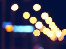 Fondo del bokeh delle iluminazioni pubbliche della città di notte Fotografia Stock