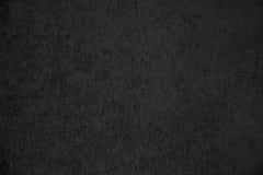 Fondo del cemento del acabamiento del edificio con la arena del color negro Foto de archivo libre de regalías