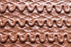 Fondo del cioccolato con il modello astratto fotografie stock libere da diritti