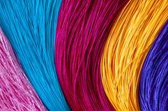 Fondo del color y textura coloridos de las borlas chinas del nudo fotos de archivo libres de regalías