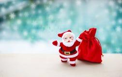 Fondo del concepto de la Navidad de Papá Noel con el bolso rojo Imagen de archivo