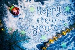 Fondo del día de fiesta del Año Nuevo en una placa oscura Fotografía de archivo libre de regalías