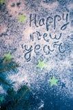 Fondo del día de fiesta del Año Nuevo en una placa oscura Imagen de archivo libre de regalías