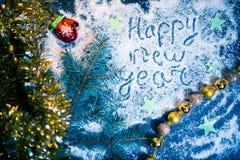Fondo del día de fiesta del Año Nuevo en una placa oscura Fotos de archivo