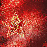 Fondo del día de fiesta con la estrella de oro Foto de archivo