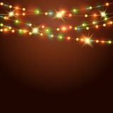 Fondo del día de fiesta con la guirnalda coloreada Fotos de archivo libres de regalías