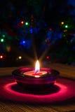 Fondo del día de fiesta de la Navidad con la vela púrpura Imagen de archivo libre de regalías
