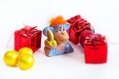 Fondo del día de fiesta del Año Nuevo con el mono rojo del pelo Fotografía de archivo libre de regalías