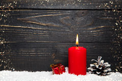 Fondo del día de fiesta del Año Nuevo con la vela roja Imagen de archivo
