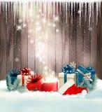 Fondo del día de fiesta de la Navidad con los presentes y la caja mágica Fotografía de archivo libre de regalías