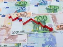 Fondo del euro y de la flecha abajo Imagen de archivo libre de regalías