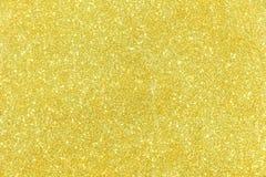 Fondo del extracto de la textura del brillo del oro Fotos de archivo libres de regalías