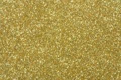 Fondo del extracto de la textura del brillo del oro Imágenes de archivo libres de regalías