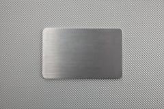 Fondo del extracto de la textura del metal con una placa Fotografía de archivo libre de regalías