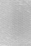 Fondo del extracto de la textura del plástico de burbujas, primer macro vertical texturizado detallado, burbujas de aire blancas  Foto de archivo